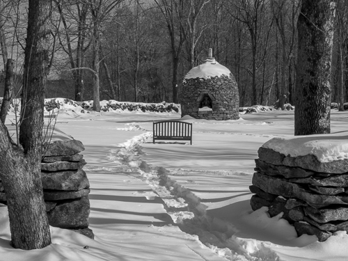 black and white, stupa and bench in snow, seen from Dharma Hall, track pathway in snow